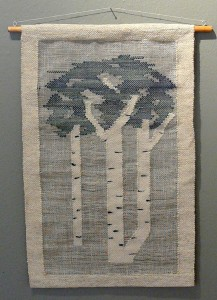 Blue weaving opf poplar trees on white fabric