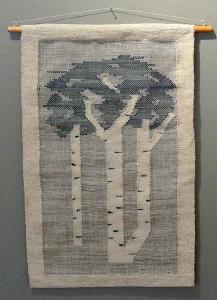Blue weaving opf poplar trees on white fabric